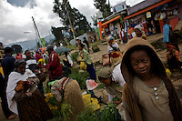 A street child begs for money while people do their purchases in the Sheromeda Market  on the last day of the year 2000 marked on the Gregorian Calender followed in Ethiopia. The image was taken on Wednesday September 10 2008 in Ethiopia's capital Addis Ababa..the Gregorian Calender marks 13 months starting on September 11 of the western calendar. In the year 2007 Ethiopians celebrated their Millennium. Currently the country struggles with two digit inflation, food commodities more than doubled in price in the last year and millions of Ethiopians depending on food aid.