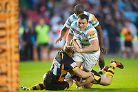 130712 Copyright onEdition 2012 ©.Free for editorial use image, please credit: onEdition..Gerard Ellis of London Irish is tackled against London Wasps at The Stoop, Twickenham in the first round of The J.P. Morgan Asset Management Premiership Rugby 7s Series...The J.P. Morgan Asset Management Premiership Rugby 7s Series kicked off again for the third season on Friday 13th July at The Stoop, Twickenham with Pool B being played at Edgeley Park, Stockport on Friday, 20th July, Pool C at Kingsholm Gloucester on Thursday, 26th July and the Final being played at The Recreation Ground, Bath on Friday 3rd August. The innovative tournament, which involves all 12 Premiership Rugby clubs, offers a fantastic platform for some of the country's finest young athletes to be exposed to the excitement, pressures and skills required to compete at an elite level...The 12 Premiership Rugby clubs are divided into three groups for the tournament, with the winner and runner up of each regional event going through to the Final. There are six games each evening, with each match consisting of two 7 minute halves with a 2 minute break at half time...For additional images please go to: http://www.w-w-i.com/jp_morgan_premiership_sevens/..For press contacts contact: Beth Begg at brandRapport on D: +44 (0)20 7932 5813 M: +44 (0)7900 88231 E: BBegg@brand-rapport.com..If you require a higher resolution image or you have any other onEdition photographic enquiries, please contact onEdition on 0845 900 2 900 or email info@onEdition.com.This image is copyright the onEdition 2012©..This image has been supplied by onEdition and must be credited onEdition. The author is asserting his full Moral rights in relation to the publication of this image. Rights for onward transmission of any image or file is not granted or implied. Changing or deleting Copyright information is illegal as specified in the Copyright, Design and Patents Act 1988. If you are in any way unsure of your right to publish this image please
