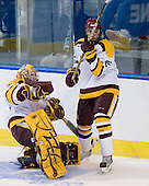 Kenny Reiter (Duluth - 35), Luke McManus (Duluth - 22) - The University of Minnesota Duluth Bulldogs defeated the University of Maine Black Bears 5-2 in their NCAA Northeast semifinal on Saturday, March 24, 2012, at the DCU Center in Worcester, Massachusetts.