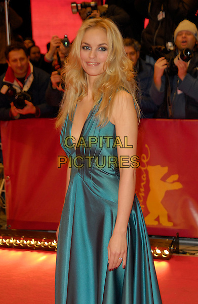 "NINA HOSS.Photocall for ""Elementary Particle"" (Elementarteilchen).56th Berlin International Film Festival (Berlinale), Berlin, Germany..February 11th, 2006.Ref: KRA.half length blue satin dress.www.capitalpictures.com.sales@capitalpictures.com.©Capital Pictures"