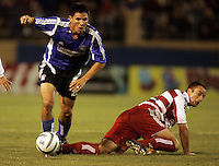 24 September 2005: Brian Ching of the Earthquakes dribbles the ball away from FC Dallas defender Steve Jolley during the first half of the game at Spartan Stadium in San Jose, California.   Earthquakes tied FC Dallas, 0-0 at halftime.