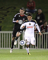 Blake Brettechneider(29) of D.C. United runs up behind Roger Torres(8) of the Philadelphia Union during a play-in game for the US Open Cup tournament at Maryland Sportsplex, in Boyds, Maryland on April 6 2011. D.C. United won 3-2 after overtime penalty kicks.