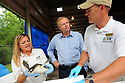 Bob Dudley, center, CEO of BP, tours the Audubon Nature Institute's turtle rehabilitation center with Michele Kelley and Dr. Robert MacLean in New Orleans, Wed., June 23, 2010.<br /> <br /> (AP Photo/Cheryl Gerber)