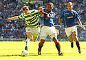 20/08/2005         Copyright Pic : James Stewart.File Name : jspa31 rangers v celtic.CRAIG BEATTIE AND JOSE PIERRE FANFAN CHALLENGE FOR THE BALL.....Payments to :.James Stewart Photo Agency 19 Carronlea Drive, Falkirk. FK2 8DN      Vat Reg No. 607 6932 25.Office     : +44 (0)1324 570906     .Mobile   : +44 (0)7721 416997.Fax         : +44 (0)1324 570906.E-mail  :  jim@jspa.co.uk.If you require further information then contact Jim Stewart on any of the numbers above.........