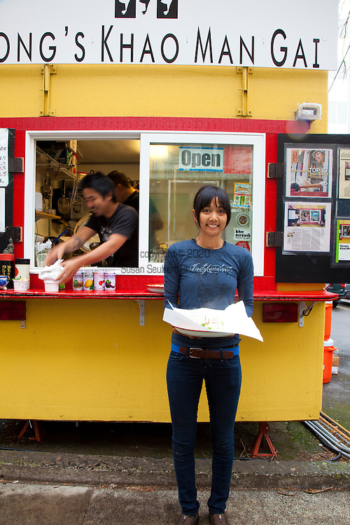 Nong's Khao Man Gai, a Thai food cart featuring the dish, Khao Man Gai, styled authentically after the street vendors of Bangkok.  Chef/Owner Nong Poonsukwattana oversees the one dish food cart in downtown Portland, Oregon. Pictured here is the owner, Nong.