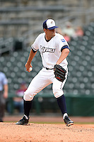 NW Arkansas Naturals pitcher Andrew Triggs (31) delivers a pitch during a game against the Corpus Christi Hooks on May 26, 2014 at Arvest Ballpark in Springdale, Arkansas.  NW Arkansas defeated Corpus Christi 5-3.  (Mike Janes/Four Seam Images)