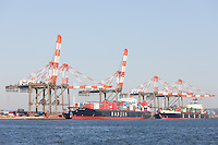 Container ships are loaded at the Maher Terminals container terminal facility in the Port Newark-Elizabeth Marine Terminal in Newark Bay.