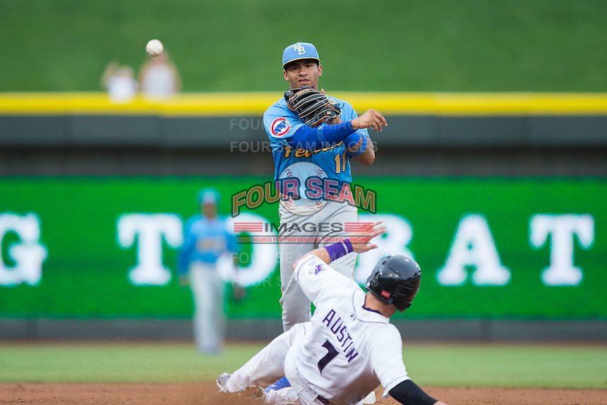 Myrtle Beach Pelicans shortstop Gleyber Torres (11) makes a throw to first base as Brett Austin (7) of the Winston-Salem Dash slides into second base at BB&T Ballpark on July 7, 2016 in Winston-Salem, North Carolina.  The Dash defeated the Pelicans 13-9.  (Brian Westerholt/Four Seam Images)