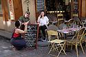 Paris, France. 09.05.2015. Customers discuss the menu, Rue Mouffetarde, 5th Arrondissement, Paris, France. Photograph © Jane Hobson.
