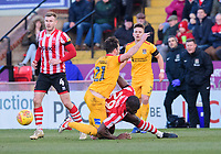 Lincoln City's John Akinde vies for possession with Northampton Town's John-Joe O'Toole<br /> <br /> Photographer Chris Vaughan/CameraSport<br /> <br /> The EFL Sky Bet League Two - Lincoln City v Northampton Town - Saturday 9th February 2019 - Sincil Bank - Lincoln<br /> <br /> World Copyright &copy; 2019 CameraSport. All rights reserved. 43 Linden Ave. Countesthorpe. Leicester. England. LE8 5PG - Tel: +44 (0) 116 277 4147 - admin@camerasport.com - www.camerasport.com
