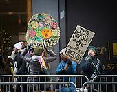 Demonstrators hold signs denouncing President-elect Donald Trump opposite Trump Tower in New York, NY, USA December 15, 2016. <br /> Credit: Albin Lohr-Jones / Pool via CNP