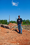 Mike stands next to new construction of the home he and his father Paul Porter will share inVaughn, Georgia August 10, 2011. In April, Vaughn was hit by a tornado that destroyed many homes in the area. Months later, the community is still picking up the pieces. The day after the tornado destroyed his properties, Paul said when he rebuilt that he would have a basement.