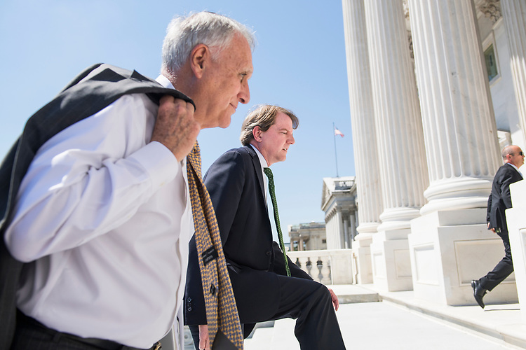 UNITED STATES - JULY 10: White House counsel Don McGahn, right, and former Sen. Jon Kyl, R-Ariz., are seen on the Capitol's Senate steps as they escort Supreme Court nominee Brett Kavanaugh and Vice President Mike Pence to meetings with senators on July 10, 2018. (Photo By Tom Williams/CQ Roll Call)