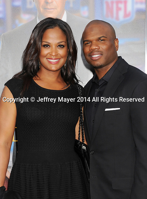 WESTWOOD, CA- APRIL 07: Former pro boxer Laila Ali (L) and husband former NFL player Curtis Conway attend the Los Angeles premiere of 'Draft Day' at the Regency Village Theatre on April 7, 2014 in Westwood, California.