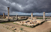 Atrium of the House of the Labours of Hercules, 2nd century AD, named for a mosaic of Hercules' 12 trials. The house is palatial with 41 rooms covering 2000 sq m, Volubilis, Northern Morocco. Volubilis was founded in the 3rd century BC by the Phoenicians and was a Roman settlement from the 1st century AD. Volubilis was a thriving Roman olive growing town until 280 AD and was settled until the 11th century. The buildings were largely destroyed by an earthquake in the 18th century and have since been excavated and partly restored. Volubilis was listed as a UNESCO World Heritage Site in 1997. Picture by Manuel Cohen
