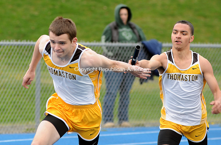 WINSTED,  CT, 24 APRIL  2012-042412JS13- Thomaston's Owen McMann, left, takes the batton from Devin Voigt during the 4x100 Meter relay during their meet with Northwestern and Wamogo Tuesday at Northwest Regional High School in Winsted. .Jim Shannon Republican-American