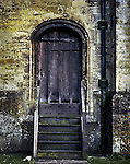 An old doorway with wooden steps