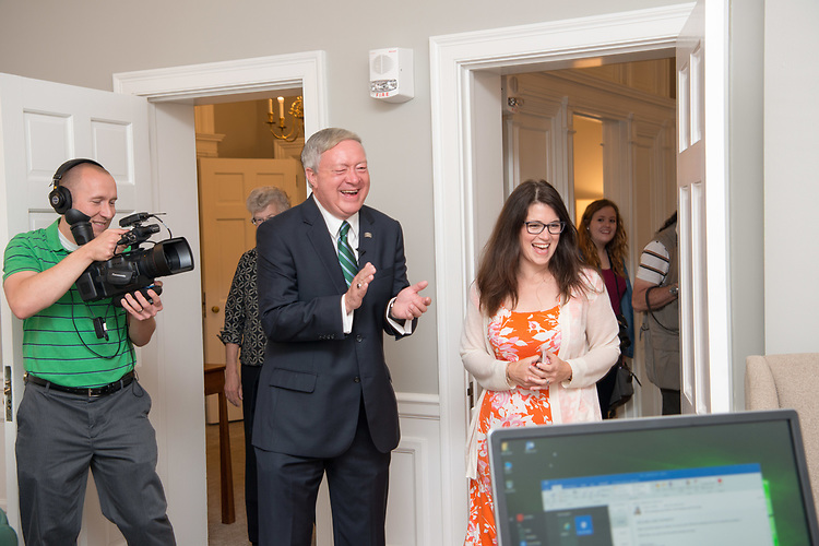 President Nellis enters his new office in Cutler Hall  with Chief of Staff Jennifer Kirksey (Right).