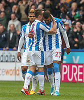 Huddersfield Town's Collin Quaner (23) celebrates scoring the winning goal with teammates<br /> <br /> Photographer Alex Dodd/CameraSport<br /> <br /> The EFL Sky Bet Championship - Huddersfield Town v Preston North End - Friday 14th April 2016 - The John Smith's Stadium - Huddersfield<br /> <br /> World Copyright &copy; 2017 CameraSport. All rights reserved. 43 Linden Ave. Countesthorpe. Leicester. England. LE8 5PG - Tel: +44 (0) 116 277 4147 - admin@camerasport.com - www.camerasport.com