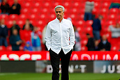 9th September 2017, bet365 Stadium, Stoke-on-Trent, England; EPL Premier League football, Stoke City versus Manchester United; Manchester United Manager Jose Mourinho looks concerned as he stands on the pitch before the game