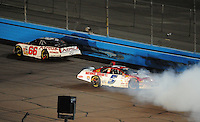 Apr 11, 2008; Avondale, AZ, USA; NASCAR Nationwide Series driver Landon Cassill (5) spins during the Bashas Supermarkets 200 at the Phoenix International Raceway. Mandatory Credit: Mark J. Rebilas-