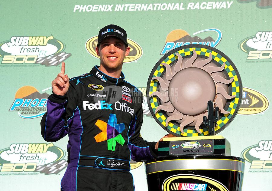 Mar. 4, 2012; Avondale, AZ, USA; NASCAR Sprint Cup Series driver Denny Hamlin celebrates after winning the Subway Fresh Fit 500 at Phoenix International Raceway. Mandatory Credit: Mark J. Rebilas-