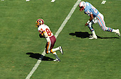 Washington Redskins wide receiver Gary Clark (84) runs with the ball after making a catch during the game against the Houston Oilers at RFK Stadium in Washington, DC on September 16, 1985.  In persuit is Oilers left cornerback Steve Brown (24).  The Redskins won the game 16 - 13.<br /> Credit: Howard L. Sachs / CNP