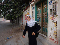 "Amira Al-Qerem (16) leaves for school from her new home in Gaza City on October 27 2010. Amira was missing and presumed dead after she was injured by one of the same explosions that killed her father, brother and sister during the last days of the Israeli invasion of Gaza in 2009. She was found three days later, after her family thought they had buried her remains with those of the other three. She is one of the main subjects of the controversial documentary film ""Tears of Gaza"" by director Vibeke Løkkeberg."