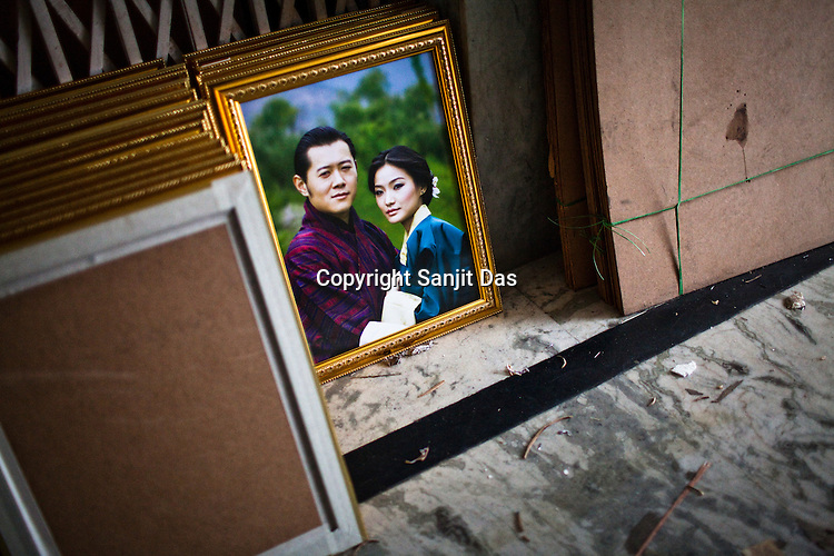 A pile of photos showing the Bhutanese King Jigme Khesar Namgyel Wangchuck and his wife-to-be, 20-year-old student Jetsun Pema at a framers' shop at the main market in Thimphu, Bhutan. The 31-year-old king of the Himalayan nation of Bhutan has said that he intends to marry in October 2011. Photo: Sanjit Das/Panos