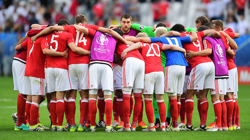 The Wales team huddle in celebration after their 2-1 victory over Slovakia<br /> <br /> Photographer Kevin Barnes/CameraSport<br /> <br /> International Football - 2016 UEFA European Championship - Group B - Wales v Slovakia - Saturday 11th June 2016 - Nouveau Stade de Bordeaux, Bordeaux<br /> <br /> World Copyright &copy; 2016 CameraSport. All rights reserved. 43 Linden Ave. Countesthorpe. Leicester. England. LE8 5PG - Tel: +44 (0) 116 277 4147 - admin@camerasport.com - www.camerasport.com