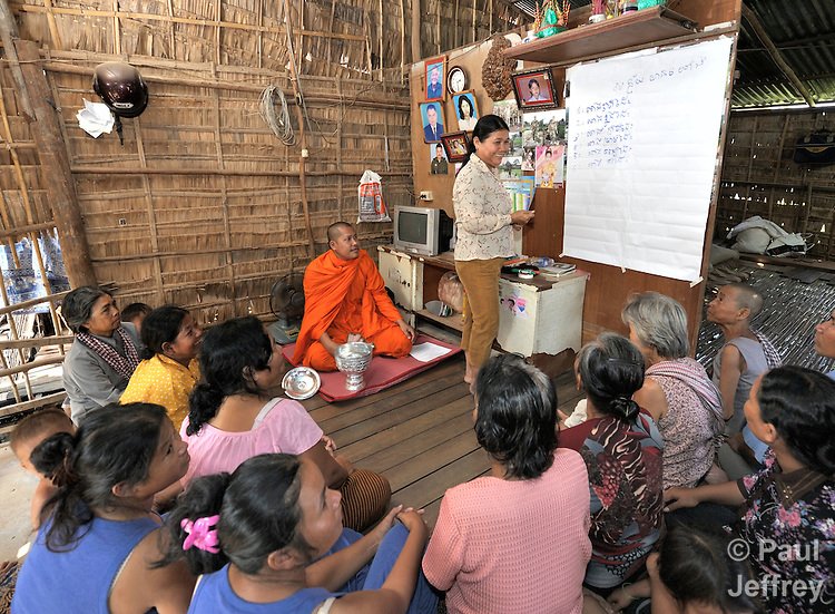 Buddhist monk Han Kimsoy meets with a self-help women's group in the Phnom Penh neighborhood of Sen Rikreay. He is one of several monks who work with the Salvation Centre Cambodia in teaching meditation techniques to people living with the HIV and AIDS. Many of the women in the group are infected or affected by the virus.