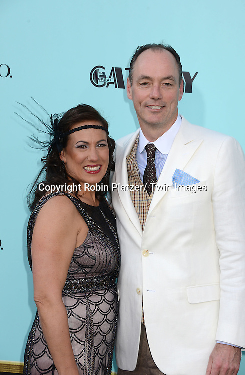 "Brenda and Tim Baxter  of Samsung attends the world Premiere of ""The Great Gatsby"" on  May 1, 2013 at Avery Fisher Hall in Lincoln Center in New York City. The movie stars Leonardo DiCaprio, Tobey Maguire, Carey Mulligan, Joel Edgerton, Isla Fisher, Amitabh Bachchan, Adelaide Clemens, Callan McAuliffe and Kate Mulvany. The movie was directed by Baz Luhrmann."