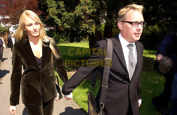 NANCY SORRELL & VIC REEVES.Leaving Maidstone Magistrates Court, .Kent, April 21st 2005.half length married husband wife holding hands suits black smart walking.www.capitalpictures.com.sales@capitalpictures.com.© Capital Pictures.