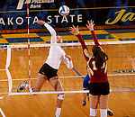 BROOKINGS, SD - OCTOBER 3:  Wagner Larson #11 from South Dakota State University winds up for a kill past Moni Corrujedo #10 from Denver in the second game of their match Friday night at Frost Arena. (Photo/Dave Eggen/Inertia)