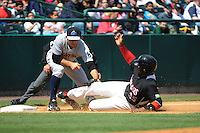 Trenton Thunder infielder Rob Segedin (26) tags out New Britain Rock Cats base runner Kennys Vargas (35) during game against the New Britain Rock Cats at New Britain Stadium on May 7 2014 in New Britain, CT.  Trenton defeated New Britain 6-4.  (Tomasso DeRosa/Four Seam Images)