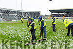 groundsmen brush snow from the pitch before the Allianz Football League Division 1 Round 5 match between Kerry and Monaghan at Fitzgerald Stadium in Killarney, on Sunday.
