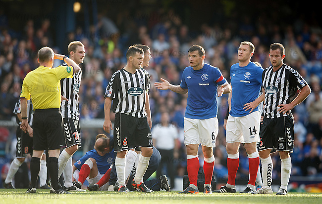Lee McCulloch doing the Captains job as he remonstrates with the referee after Lewis Macleod's tumble