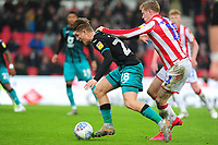 George Byers of Swansea City vies for possession with James McClean of Stoke City during the Sky Bet Championship match between Stoke City and Swansea City at the Bet 365 Stadium in Stoke-on-Trent, England, UK. Saturday 25 January 2020