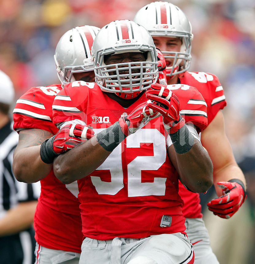 Ohio State Buckeyes defensive lineman Adolphus Washington (92) celebrates after making a stop in the back field against Navy in the 2nd quarter of their NCAA game at M&T Bank Stadium in Baltimore, Maryland on August 30, 2014. (Dispatch photo by Kyle Robertson)