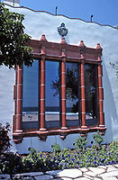 The Adamson House, designed by a well-known architect, Stiles Clements, was constructed beginning in 1929. Detail of Moorish window treatment. Situated near the Malibu Pier between popular Surfrider Beach and the Malibu Lagoon, the house boasts an exotic mix of Spanish and Moorish influences.It is now the Malibu Lagoon Museum. Photo--July 1989.