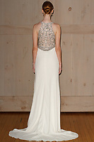 Model poses in a Jenny Packham bridal gown for the David's Bridal Fall 2017 fashion show presentation on April 19, 2017; during New York Bridal Fashion Week.