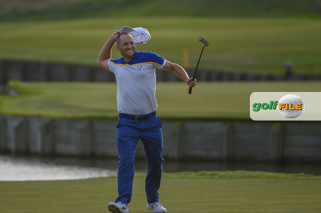 Alex Noran (Team Europe) celebrates sinking his long birdie putt on 18 to ice the cake on a Team Europe win following  Sunday's singles of the 2018 Ryder Cup, Le Golf National, Guyancourt, France. 9/30/2018.<br /> Picture: Golffile | Ken Murray<br /> <br /> <br /> All photo usage must carry mandatory copyright credit (© Golffile | Ken Murray)