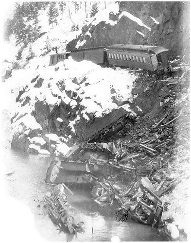 Wreck near Tacoma on 12-27-1921.  Southbound hit rock slide at MP 471.1.  Engineer John Connor was killed.  Engine with snow plow slid down hillside into Animas River.<br /> D&amp;RG  near Tacoma, CO  Taken by Ballough, Monte - 12/27/1921