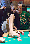 William Rockwell plays poker with his feet, after losing the use of his arms in a motorcycle accident.  He cashed in this tournament, his best ever finish in a WPT event.
