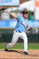 Rochester Red Wings pitcher Michael Tonkin #59 delivers a pitch during a game against the Gwinnett Braves on June 16, 2013 at Frontier Field in Rochester, New York.  Rochester defeated Gwinnett 6-3.  (Mike Janes/Four Seam Images)