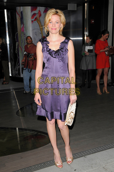 "ELIZABETH BANKS.Prada's Private Screening of the new Animated Short Fil ""Trembled Blossoms"" held at Prafa Beverly Hills Epicenter in Beverly Hills, California, USA..March 19th, 2008.full length purple silk satin ruffles ruffled dress cream beige clutch bag purse shoes .CAP/DVS.©Debbie VanStory/Capital Pictures."