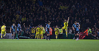 Liam Sercombe of Oxford United celebrates his goal with teammates as away supporters put onto the field during the Sky Bet League 2 match between Wycombe Wanderers and Oxford United at Adams Park, High Wycombe, England on 19 December 2015. Photo by Andy Rowland.