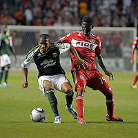 Portland defender Jeremy Hall (17) controls the ball while being pressured by Chicago forward Patrick Nyarko (14).  The Portland Timbers defeated the Chicago Fire 1-0 at Toyota Park in Bridgeview, IL on July 16, 2011.