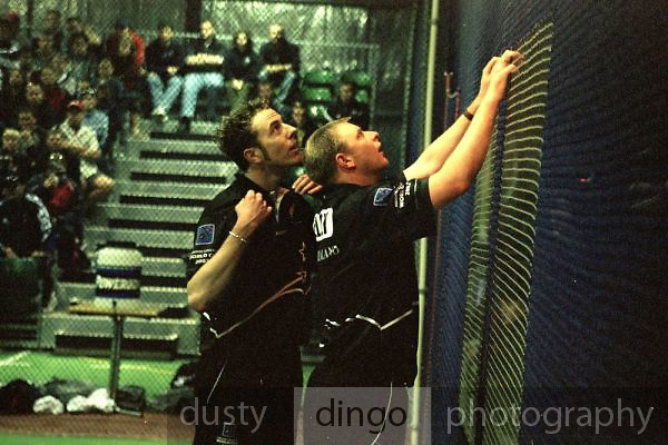 Iain O'Brien, who was later to  play for the New Zealand National Cricket Team, and NZ Captain Leigh Kelly, discuss a point with the umpires.<br /> 2002 Indoor Cricket World Cup, Wellington, New Zealand