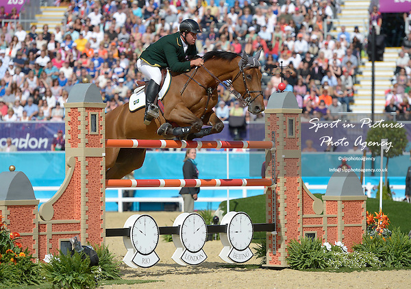 Reynoso Fernandez filho riding Maestro St Lois (BRA, Brazil). Team Showjumping - PHOTO: Mandatory by-line: Garry Bowden/SIP/Pinnacle - Photo Agency UK Tel: +44(0)1363 881025 - Mobile:0797 1270 681 - VAT Reg No: 768 6958 48 - 06/08/2012 - 2012 Olympics - Greenwich Park, London, England